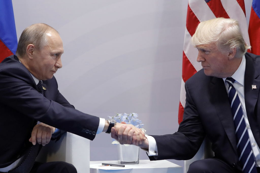 HAMBURG, GERMANY  JULY 7, 2017: Russia's President Vladimir Putin (L) and US President Donald Trump shake hands during a bilateral meeting on the sidelines of the G20 summit in Hamburg. Mikhail Metzel/TASS (Photo by Mikhail MetzelTASS via Getty Images)