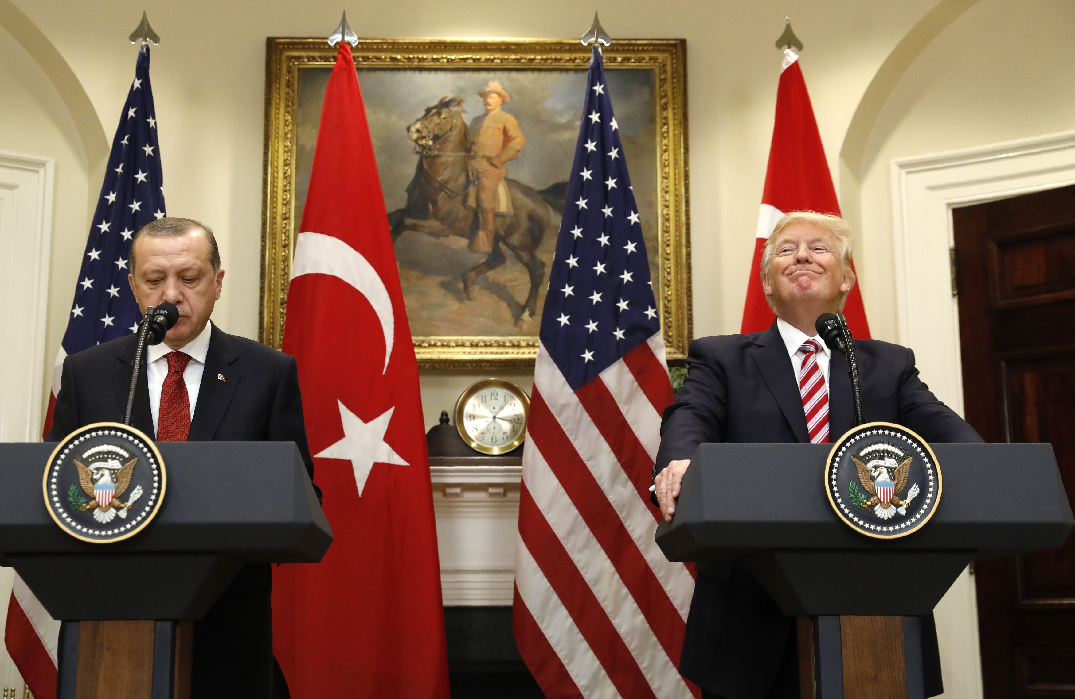 Turkey's President Recep Tayyip Erdogan (L) and U.S President Donald Trump deliver statements to reporters in the Roosevelt Room of the White House in Washington, U.S. May 16, 2017. REUTERS/Kevin Lamarque